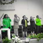People singing in microphones.